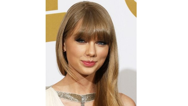 Taylor Swift's Lash Grazing Bangs