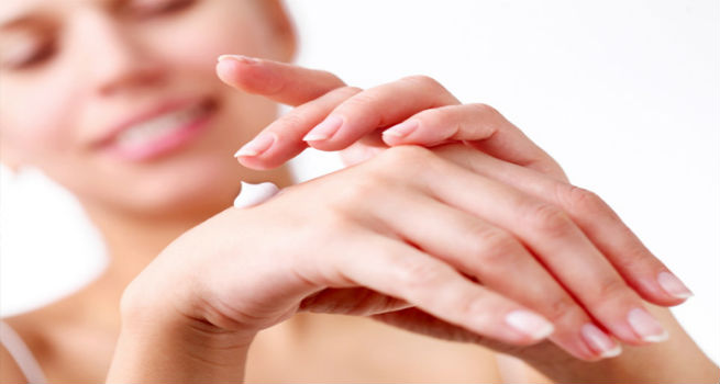 applying hand cream beauty habit